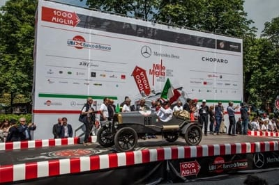 Brian Thorley of CCTI in the 2015 Mille Miglia crossing the finishing line in Brescia. Join us on our 2019 tour to watch the Mille Miglia