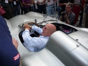 Stirling Moss at the Mille Miglia in 2008. Join us on our 2019 tour to watch the Mille Miglia