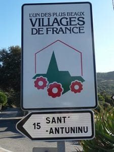 Corsica sign to Sant-Antuninu, one of France's most beautiful villages.Join us on our 2017 Corsica car tour.