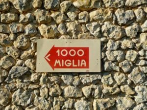 Mille Miglia sign on a wall in Italy.Join us on our tour to watch the 2018 Mille Miglia